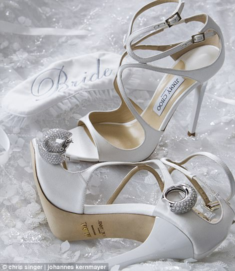 4195AB1100000578-4622612-The_bride_donned_a_white_pair_of_Jimmy_Choo_heels_embellished_wi-a-123_1497985527745
